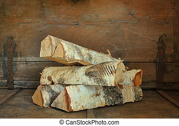Firewood - A pile of firewood on old chest with rusty...
