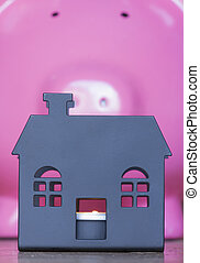 Repossessed property - house silhouette with piggy bank