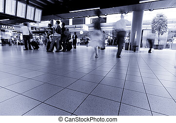people traveling at the airport Used a long exposure for...