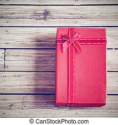 Red present box with retro filter effect