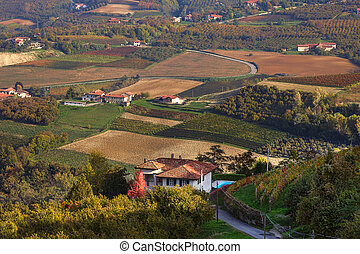 Rural house and autumnal fields in Italy - View of lone...