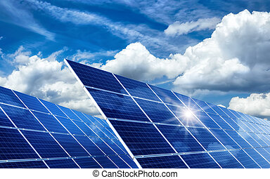 Solar panels reflecting the sun and clouds - Two large solar...