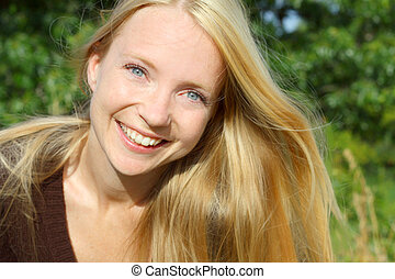 Happy Woman Outside - a young, attractive, 30 year old woman...
