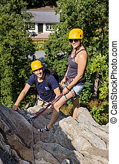 Climbers With Safety Equipment Relaxing On Rock - Portrait...