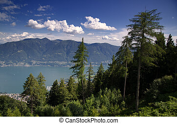 Panorama view over mountains and an alpine lake maggiore...