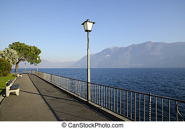 Lakefront with mountain - Lakefront with benches and trees...