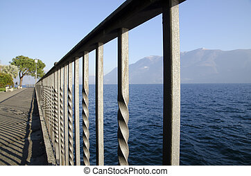 Lakefront with mountain - Lakefront with fence and benches...