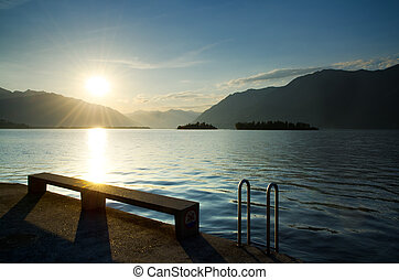 Sunrise over a lake with mountain - Sunrise over an alpine...