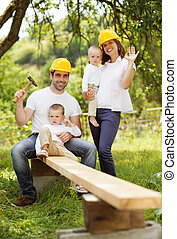 Builders - Young family is doing a building work together