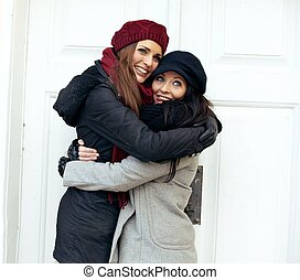 Cheerful Women Giving Each Other a Hug