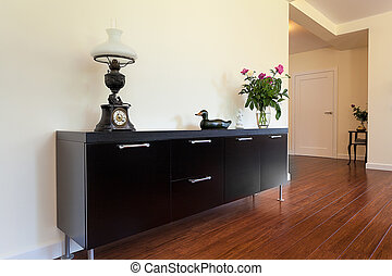 Bright space - black cabinet - Bright space - an elegant...
