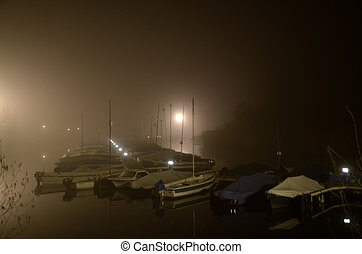 Port at night in the fog