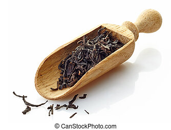 wooden scoop with black tea Assam