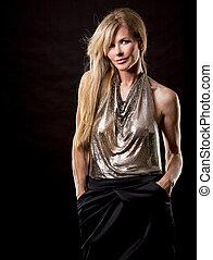 blond fashion woman - pretty blond wearing shiny top on...