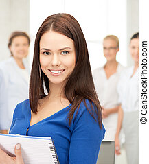 happy woman with big notepad - office, buisness, education...
