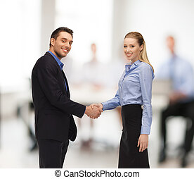 man and woman shaking their hands - office, buisness,...