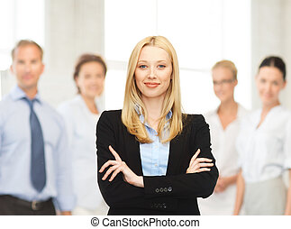 smiling businesswoman - office, buisness, teamwork concept -...