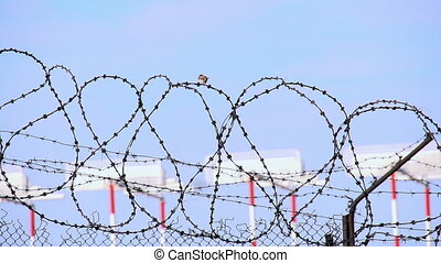 Restricted Area - Fence of barbed wire around the protected...