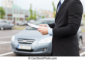 man with car documents outside - transportation and...
