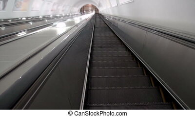 Descend on the escalator - Descending to the metro in great...
