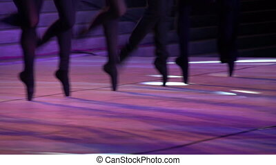 Ballet Step - Dancers make moves synchronously standing on...