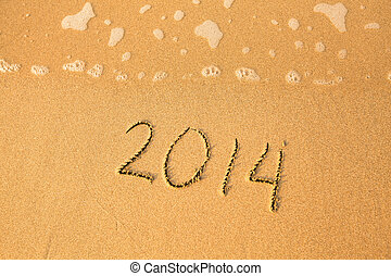 2014 - written in sand on beach texture, soft wave of the sea