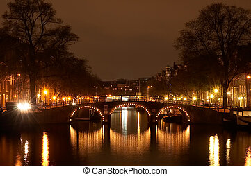 Amsterdam at night - canals in Amsterdam at night photo...