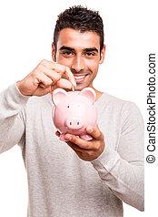 Man saving money to a piggy bank - Beautiful man saving...