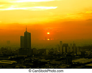 Smog over Manila - Rays of afternoon sunlight making a vain...