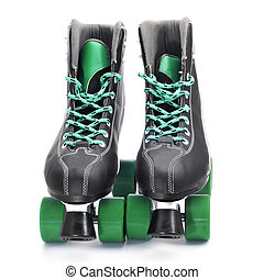 roller skates - a pair of roller skates on a white...