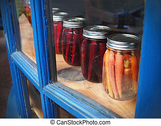 Pickled Vegetables In Mason Jars - A row of carrots and...