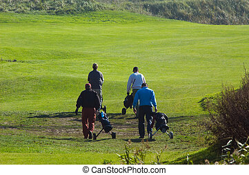 people playing golf - people walking on the golf course
