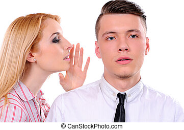 Business - Portrait of young woman telling a secret to a man...
