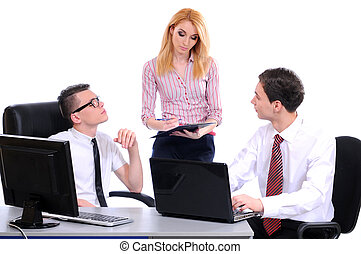 Business - A business team of three plan work in office...