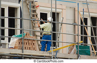 building a house  - construction workers building a house