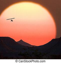 Namibian Sunset - Microlight aircraft and a Namibian Sunset...