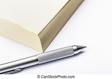Memo pad and pen close up