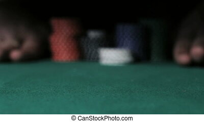 Casino. Poker Player going all-in.