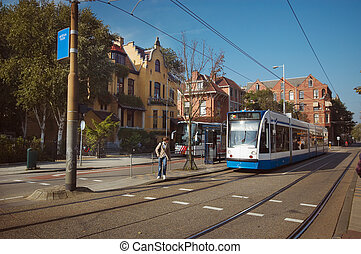 transport in amsterdam - A tram in amsterdam near the...