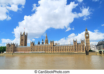 Big Ben Tower and Houses of Parliament in London under blue...