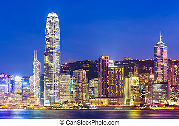 Hong Kong city skyline at night with Victoria Harbor and...