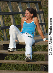 woman exercise - woman resting after exercise