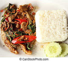 A fresh dish of Thai style food, Fried pork with sweet basi...