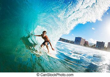 Surfer Gettting Barreled - Surfer on Blue Ocean Wave in the...