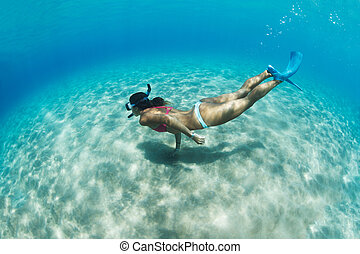 Woman snorkeling in tropical sea - Underwater image of a...