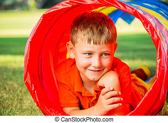 Young Boy Playing - Cute Young Boy Playing Outside in...