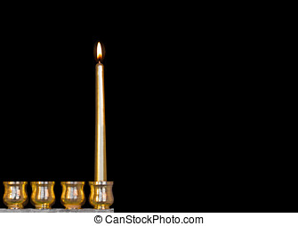 One Jewish holiday Chanukah candle - Bright, shiny yellow...