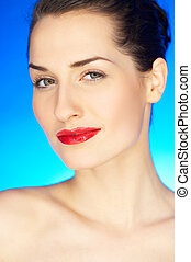 Red Lips on Blue - Portrait of 20-25 years old beautiful...
