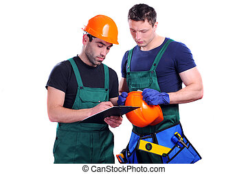 Construction Worker - two construction men discuss project...