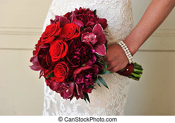 Bridal Bouquet - Image of a bride bouquet with red roses and...
